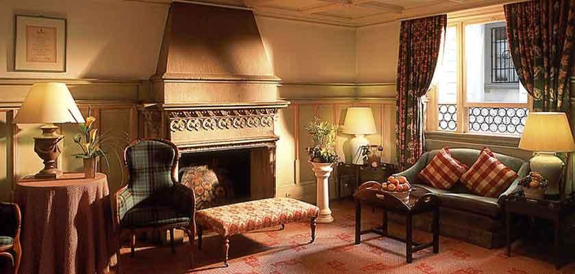 Hotel Wilden Mann, Lucerne, Switzerland - hotel lounge with fireplace.jpg